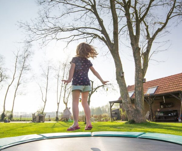 What are the safety measures you have to take while riding on a trampoline?